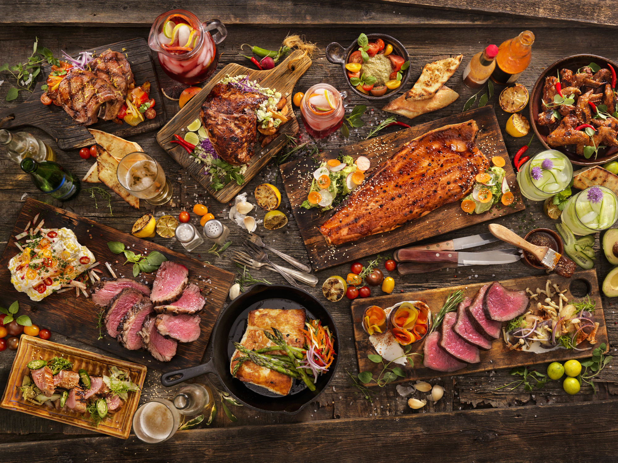 Assorted cuts of meat on a wooden table.